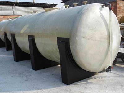 Horizontal FRP tanks are stored on the yard.