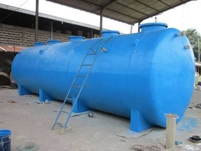 There is a FRP chemical storage tank in blue with a ladder.