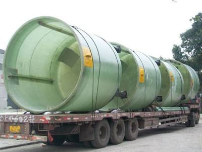 FRP agitator tanks are delivered by a truck.
