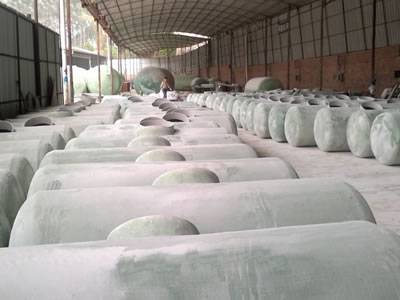 FRP septic vessels are stored in the warehouse.