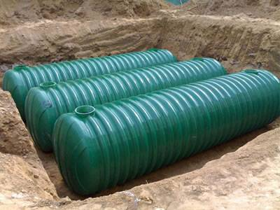 Three threaded FRP septic tanks with green coated are set underground.
