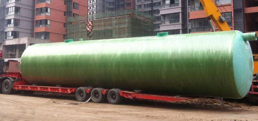 A FRP septic vessel in large size is delivered to a construction site.