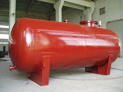 This is a FRP chemical storage tank in red.
