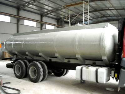 There is a FRP transportation tank with white coated.