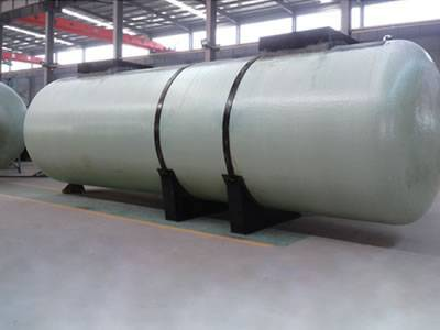 There is a double-wall FRP oil storage tank with two saddle supports.